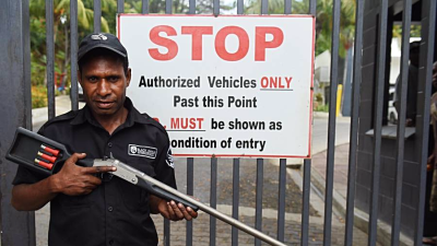 Security guard with shotgun outside Airways Hotel  Port Moresby (AAP)