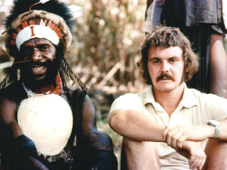 Chris Owen with an Enga man during the filming of Tighten The Drums in 1974
