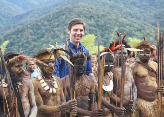 Eric Tlozek with Ikundi villagers