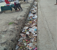 Drain filled with rubbish