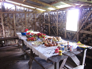 Kokoda - Lunch of baked goods and fruit prepared by women of Abuari village