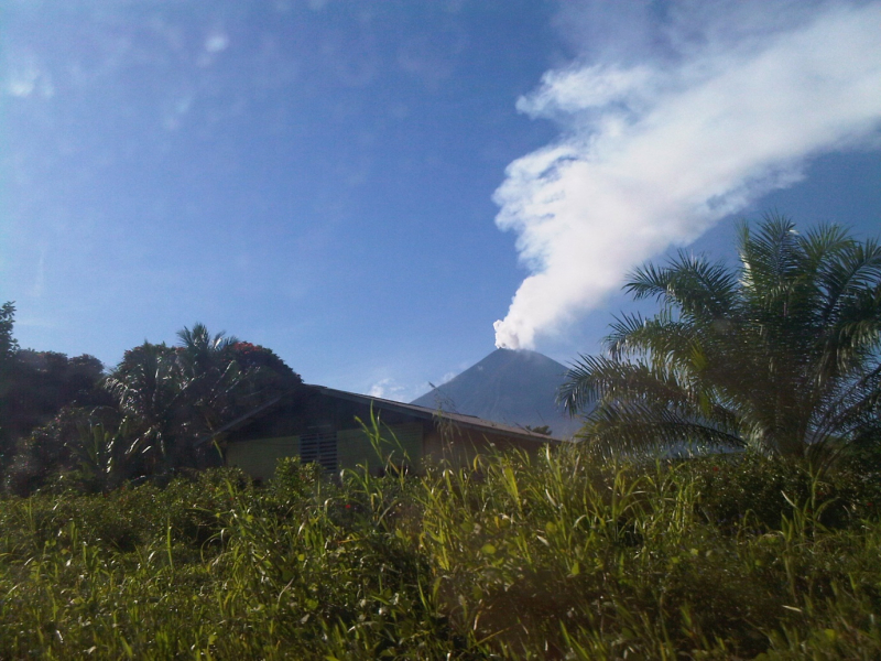 Steam rising from the summit as seen from Ulamona Mission