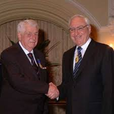 Gus Bottrill receives his OAM from Dr Ken Michael  Governor of Western Australia  2008