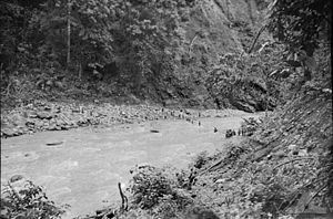 Anzac - Late January 1942. Australian soldiers retreat from Rabaul cross the Warangoi-Adler River in the Bainings Mountains (Sgt Les Robbins)