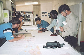 David Osikore (second right) briefs colleagues about the Wafi gold deposit south of Lae (Mike Porter)
