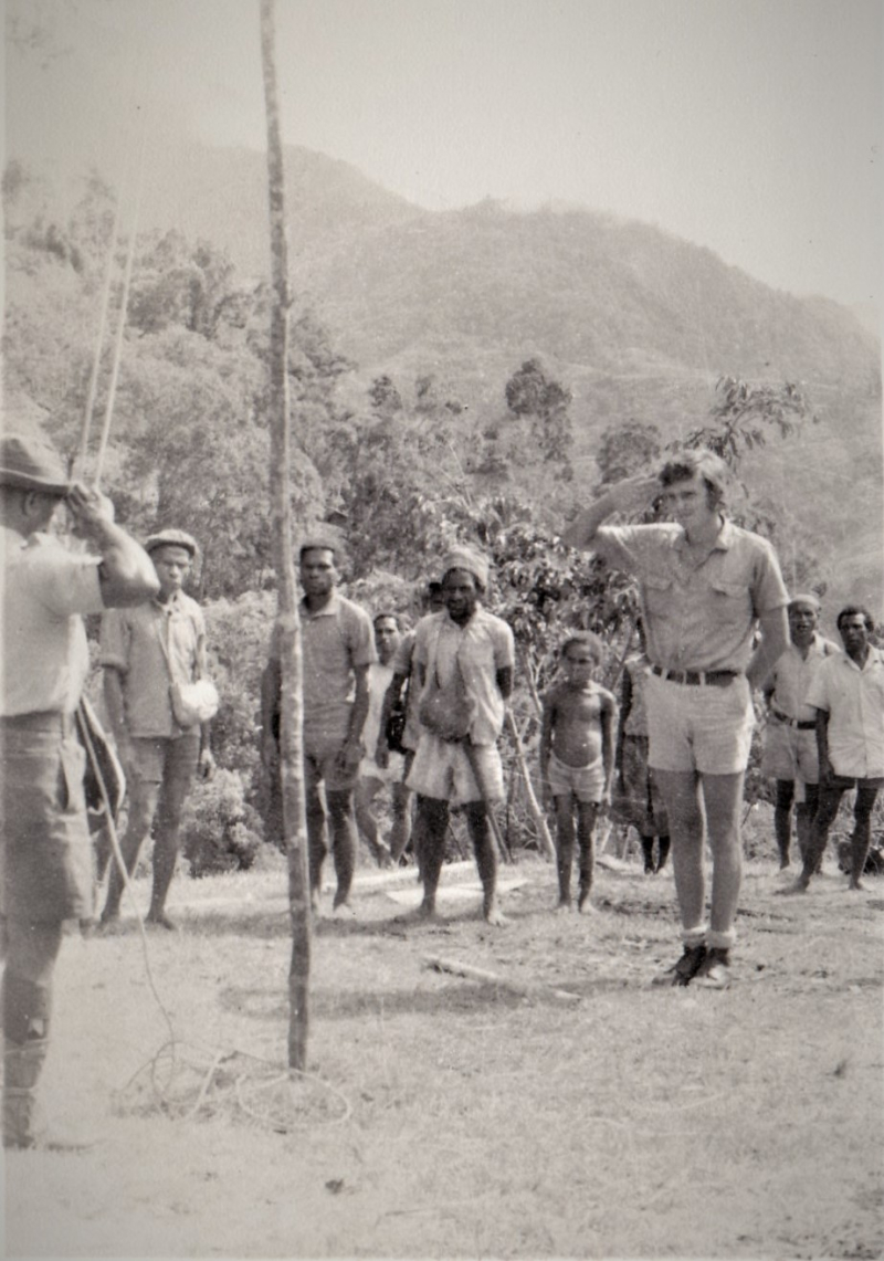 Independence - Showing the new flag to a remote community  PNG Highlands  1974  (Graham Forster)