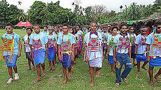 Students parade with bilums