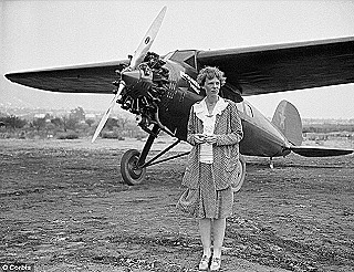 Amelia Earhart posing by her plane in Long Beach  California  1930