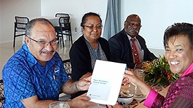 A happy Peter O'Neill receives the Observer Group report from Commonwealth secretary-general Patricia Scotland