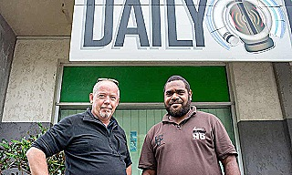 Dan McGarry (left) outside the offices of Vanuatu's Daily Post in Port Vila