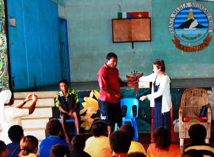 Marcia Luecke visited the Santa Maria Secondary School on Goodenough Island  where she gave an impromptu homily on Easter Sunday  2017. She is shown donating a memorial plaque honoring her father