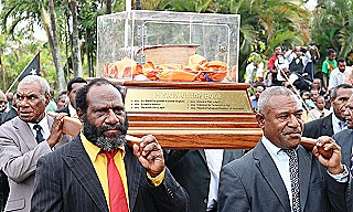 The 404 year old King James Bible is ceremonially borne into the PNG parliament
