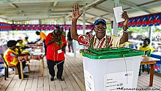 A jubilant voter casts his ballot in Bougainville's referendm (Post-Courier)