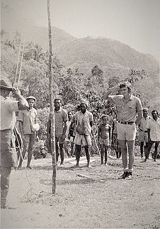 The new flag is raised in a remote community  PNG Highlands  1974  (Graham Forster)