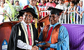 UPNG chancellor Robert Igara presents Charles with his degree