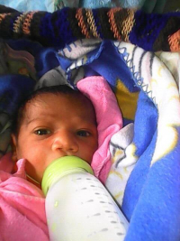 Kerema - grandchild Clinton born 6 days before Independence Day