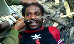 Terrified Papuan tortured with a machete by an Indonesian soldier