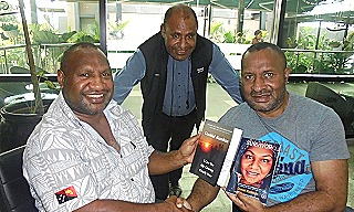 James Marape and Minister Dr Lino Tom with two of Daniel's books a few days before  he was elected PM. Looking on is Peter Mis
