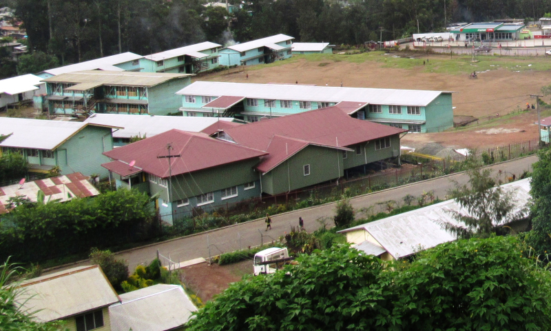 Maroon building at Wabag Primary houses school library with very few books