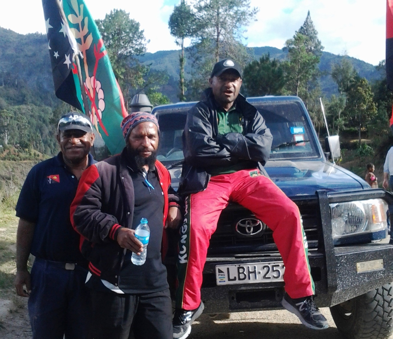 Daniel kumbon with fellow authors Baka Bina and Jimmy Drekore at Gembogl in the foothills of Mt Wilhelm  2016
