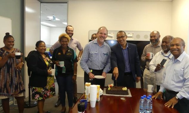 Ian Ling-Stuckey (right centre) and staff celebrate six months of hard work
