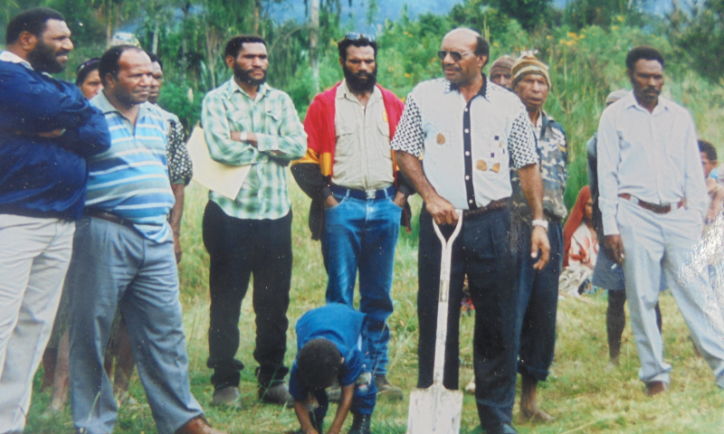 Sir Albert Kipalan (with spade) on the spot where Fr Jerry Bus settled at Kopen