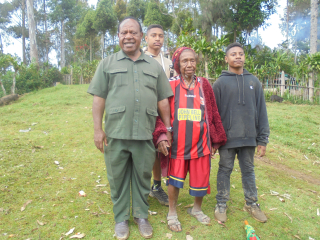 Cr Paul  Kiap Kurai with his father's last wife Kipaukwan and some of his children at Kaiap village_