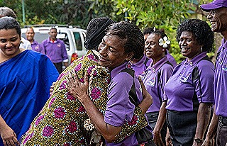 UNAIDS Winnie-Byanyima-is-greeted-by-outreach-workers-at-Begabari-HIV-Clinic