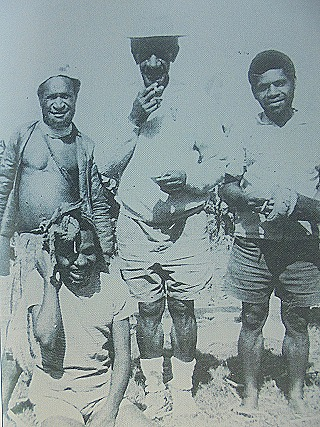 Paul Kiap Kurai sitting as his father(centre) towers over him  after Form 4 examinations in 1975