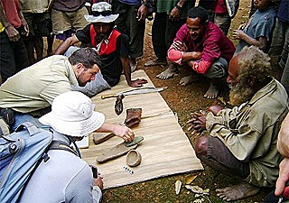Dr Ben Shaw and villagers examine artifacts unearthed at Waim (UNSW - Ben Shaw)