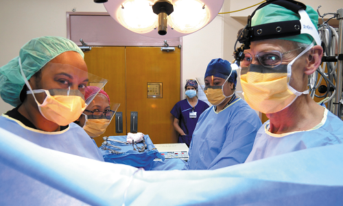 Dr Elizabeth Alok (left) in the operating theatre