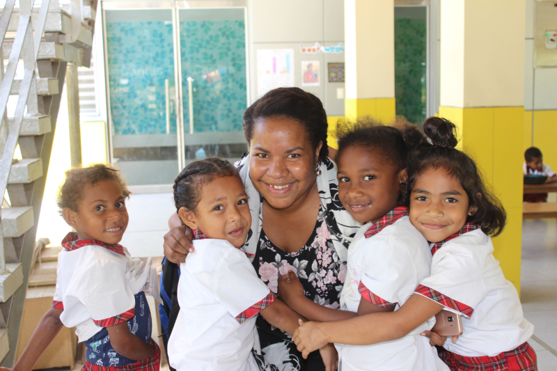 Caroline Evari and students from Caritas Elementary school in Port Moresby
