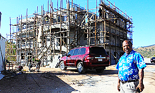 Paul Kurai outside his new house being built in Port Moresby_
