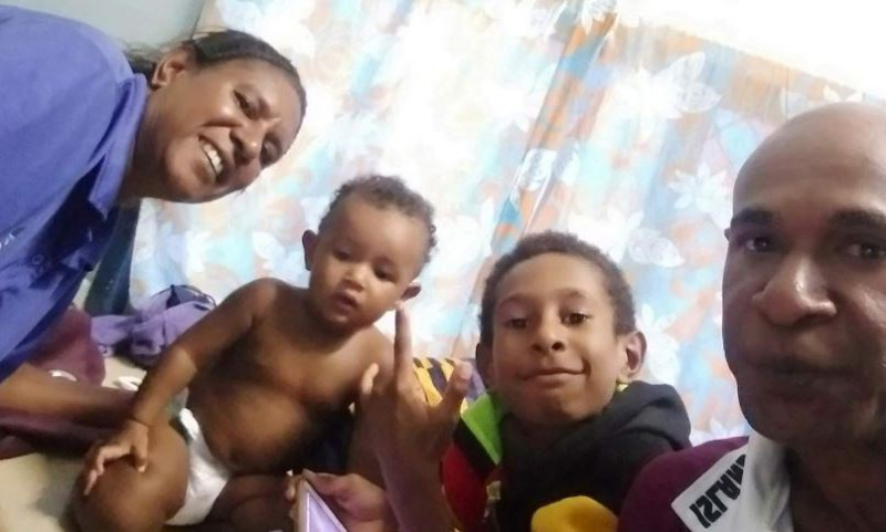 Last photo Nagoi Jimmy took with his family  before borders closed in March 2020 (Supplied to ABC)