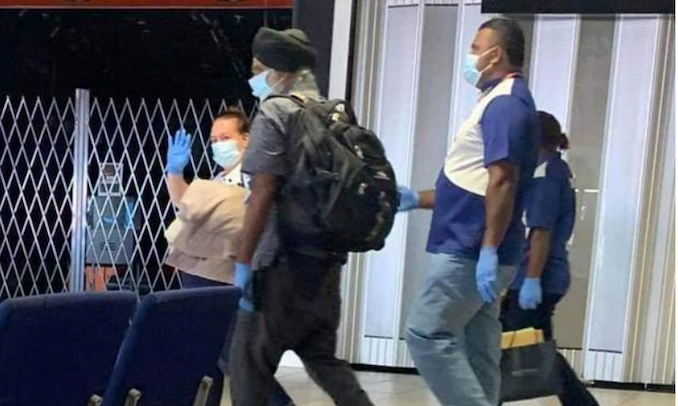 Prof Pal Ahluwalia his wife Sandra Price escorted to their aircraft by Fiji officials at Nadi International Airport (Pacific Newsrooom)