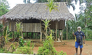 Kumbon - Michael Yahu in front of his village house in Manus