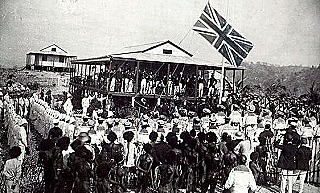 Hoisting the British flag at Port Moresby