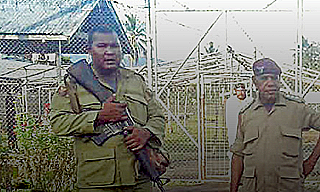 Armed guards at Giligili jail