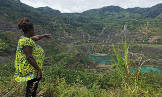 "We live with the impacts of Panguna every day "" said Theonila Roka Matbob  local landowner and Bougainville education minister  pictured at the closed Panguna mine pit last year (Human Rights Law Centre)"