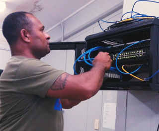 3 - PNGDF IT staff Captain Quinten Uvia checking a series along the network