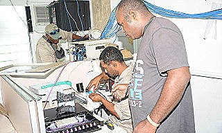 2 - IT staff upgrade existing network switches within the Force Logistics Branch