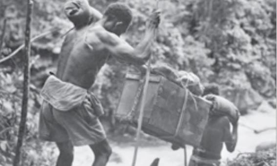 Carriers walked long distances carrying heavy loads of wounded troops  supplies and equipment (Damien Parer  1942)