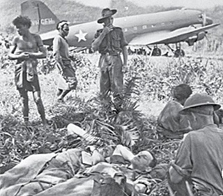 Carriers assisting wounded soldiers