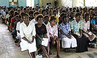 Youths listen to President Toroama