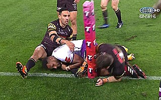 Justin Olam scores the first try of the NRL grand final