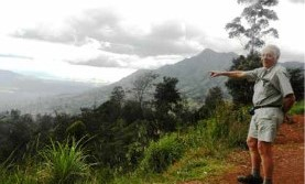Bob Cleland points out the panorama of the Asaro Valley from Daulo Pass  in the Eastern Highlands  in 2012