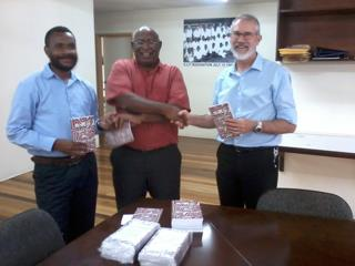 Jelliffe - Handing over books to ECPNG reprfesentatives in Port Moresby