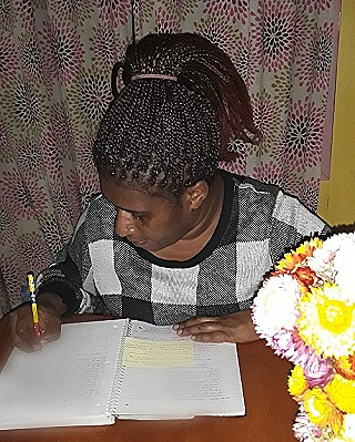Dominica at her writing desk