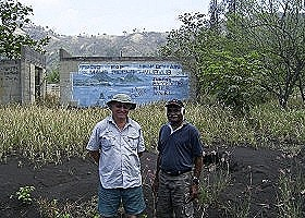 Sam and Kj in front of the devastated Radio ENB  Rabaul
