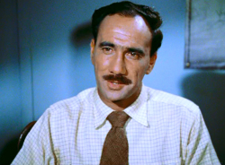 Fred in the role of a District Officer in the film Walk into Paradise
